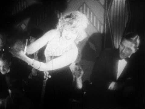 b/w 1928 woman using castanets + smiling in nightclub floor show / newsreel - 1928 stock videos & royalty-free footage