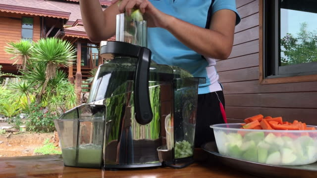 woman using centrifuge machine to prepare juice - centrifuge stock videos & royalty-free footage