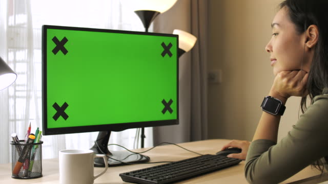 woman using computer green screen at home - computer monitor stock videos & royalty-free footage
