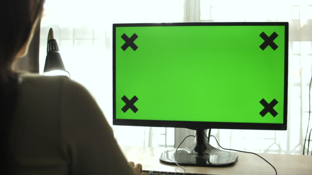 woman using computer green screen at home - over the shoulder view stock videos & royalty-free footage