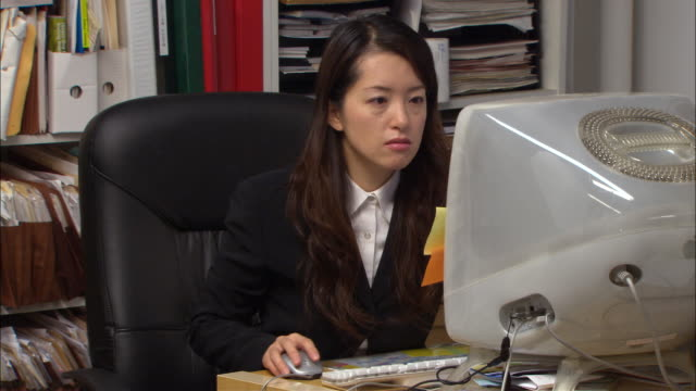 CU, Woman using computer in office