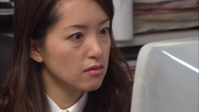 cu, woman using computer in office - only mid adult women stock videos and b-roll footage