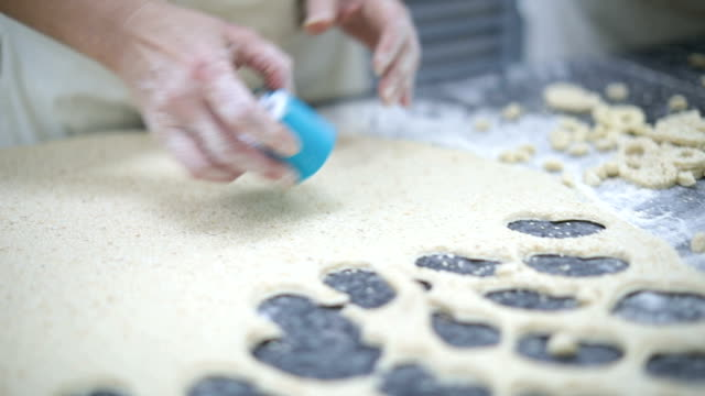 woman using cookie cutter to cut dough - caterer stock videos and b-roll footage