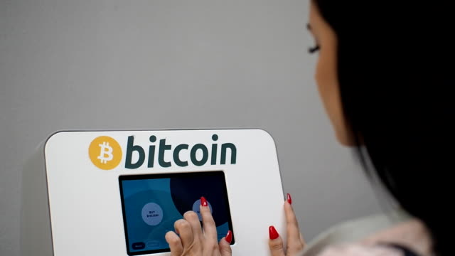 woman using cryptocurrency atm - bitcoin stock videos and b-roll footage
