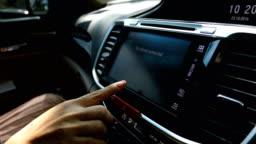 woman using dashboard touch screen in modern car