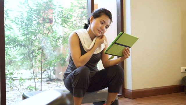 woman using digital tablet at gym - sports hall stock videos & royalty-free footage