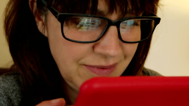 woman using digital tablet, glasses reflections. - search engine stock videos & royalty-free footage