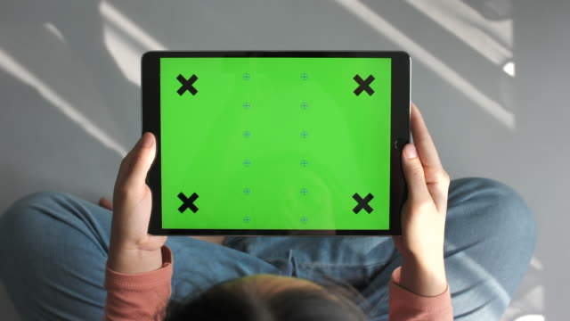 woman using digital tablet green screen, horizontal - device screen stock videos & royalty-free footage