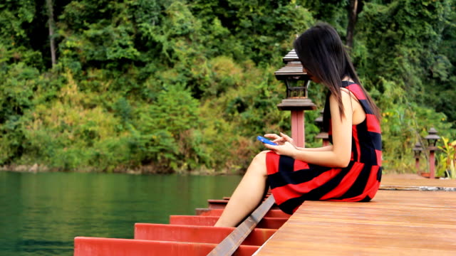 woman using digital tablet in nature - surat thani province stock videos & royalty-free footage