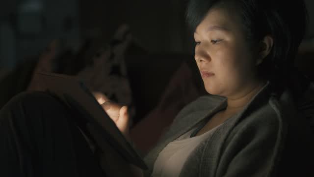 woman using digital tablet - information medium stock videos & royalty-free footage