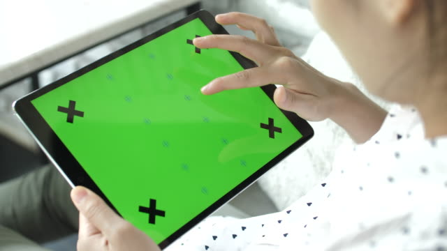 woman using digital tablet with green screen on monitor, horizontal - choosing stock videos & royalty-free footage