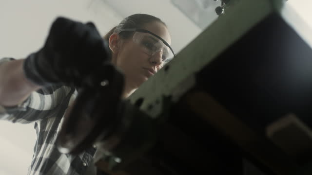 woman using drill machine - safety glasses stock videos & royalty-free footage