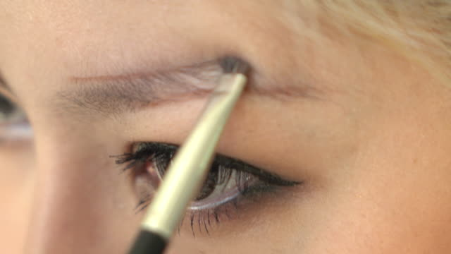 woman using eyebrow brush makeup beauty
