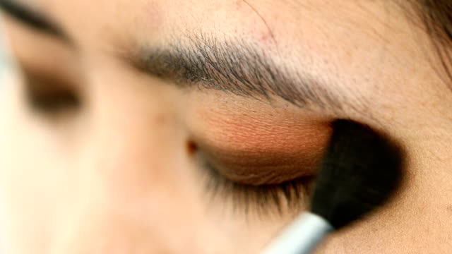woman using eyeshadow brush makeup beauty - blusher make up stock videos and b-roll footage