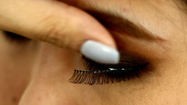 woman using false eyelash makeup beauty