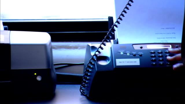 CU, PAN, Woman using fax machine in office