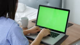 Woman using green screen at Home