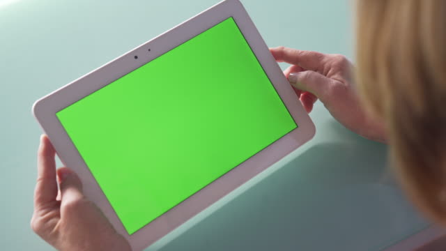 woman using green screen tablet - over the shoulder stock videos & royalty-free footage