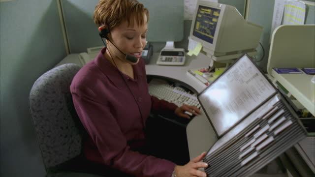 ms zi woman using headset in office / johnson city, texas, usa - johnson city texas stock videos & royalty-free footage