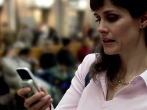 woman using her mobile phone sweden. - nur frauen über 40 stock-videos und b-roll-filmmaterial
