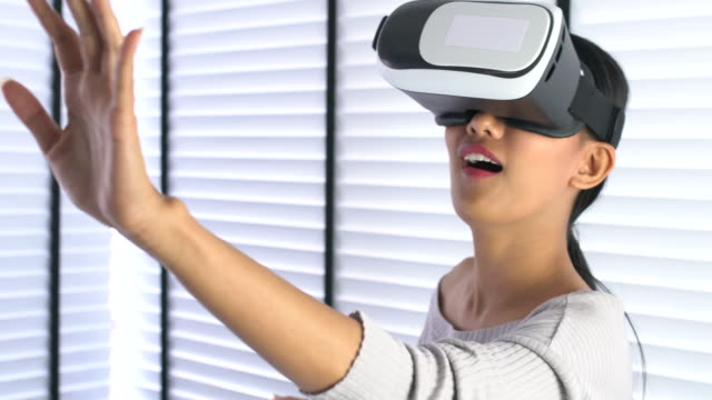 woman using her mobile phone VR headset