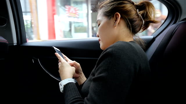 woman using her phone in car - digital viewfinder stock videos & royalty-free footage