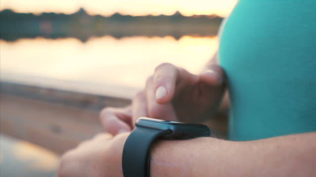 woman using her smartwatch. - smart watch stock videos & royalty-free footage