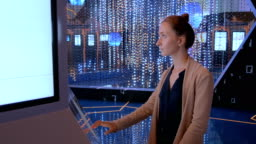 Woman using interactive touchscreen display at modern technology exhibition