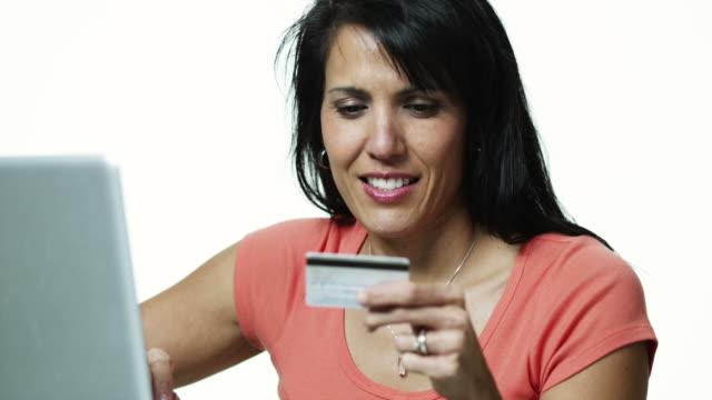 ms woman using laptop and credit card / orem, utah, usa - polynesischer abstammung stock-videos und b-roll-filmmaterial