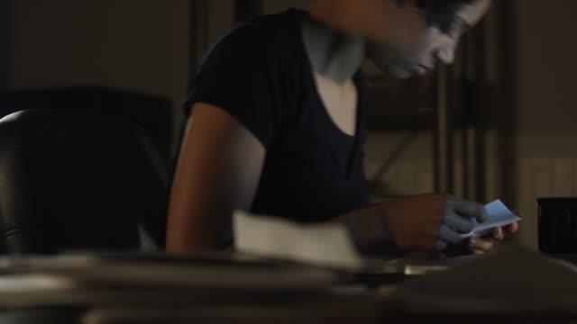 ms tu woman using laptop at home at night / orem, utah, usa - orem bildbanksvideor och videomaterial från bakom kulisserna