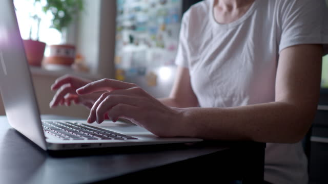 woman using laptop at home - hot desking stock videos & royalty-free footage