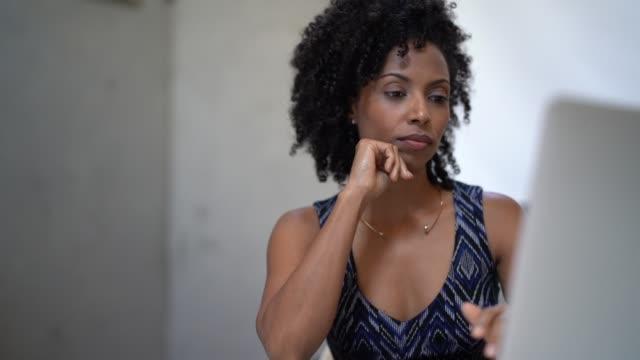 woman using laptop at workplace - pardo brazilian stock videos & royalty-free footage