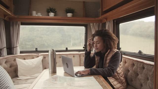 woman using laptop in camper van - portability stock videos & royalty-free footage
