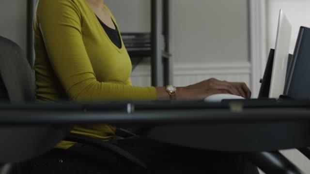 vídeos de stock, filmes e b-roll de ms tu woman using laptop in office / orem, utah, usa - parte de uma série