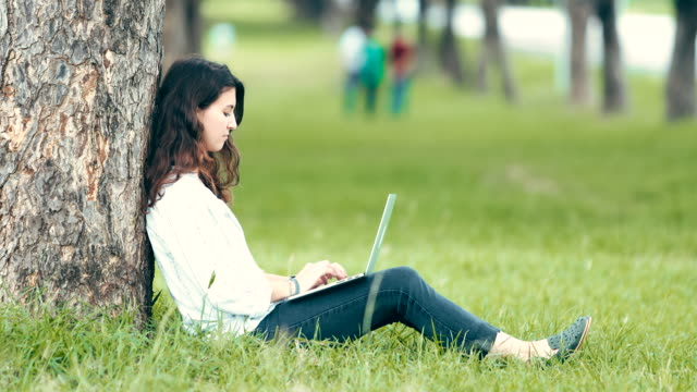 woman using laptop in the outdoor garden - web address stock videos & royalty-free footage