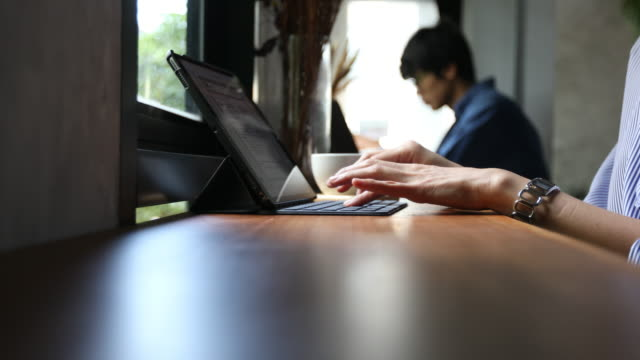 woman using laptop in the restaurant - coffee drink stock videos and b-roll footage