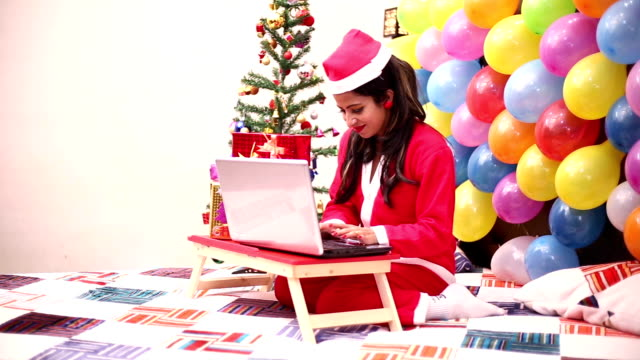 woman using laptop on christmas day, online chat - home shopping stock videos & royalty-free footage