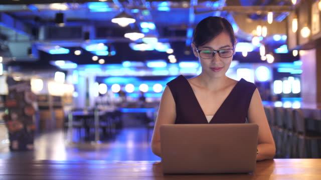 woman using laptop - japan stock videos & royalty-free footage