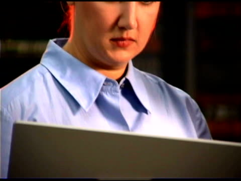woman using laptop - one mid adult woman only stock videos & royalty-free footage