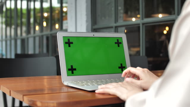 woman using laptop with green screen - computer monitor over shoulder stock videos & royalty-free footage