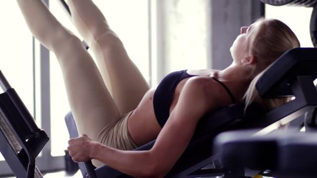 woman using leg press machine - leg press stock videos & royalty-free footage