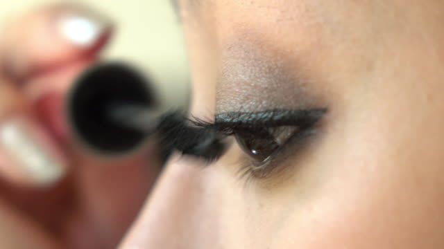 woman using mascara eye makeup beauty