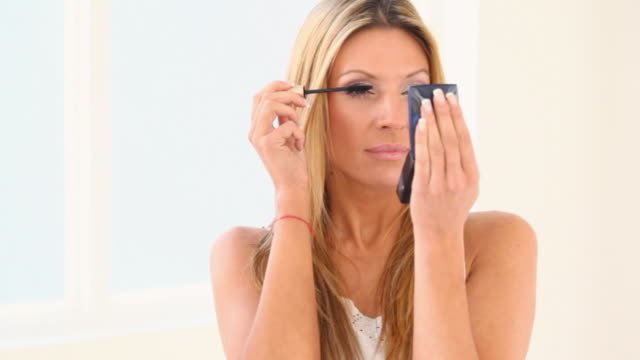 hd 720 woman using mascara - mirror object stock videos and b-roll footage