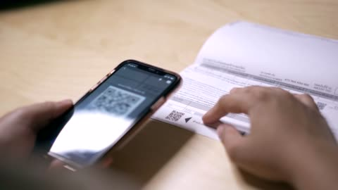 a woman using mobile phone for application qr code payment at home - exchanging stock videos & royalty-free footage