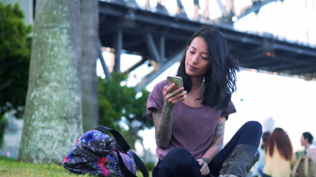 Woman using mobile phone in Sydney