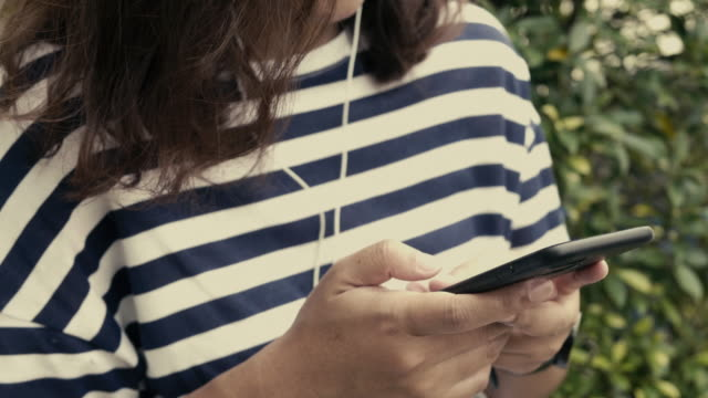 woman using mobile phone - todchamp stock videos and b-roll footage