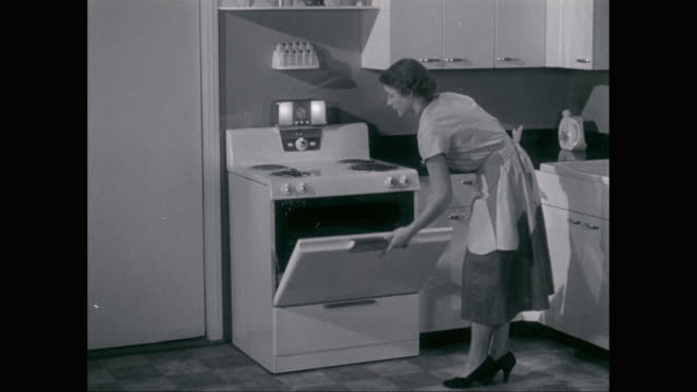 ms zi woman using oven in kitchen / united states - cooker stock videos and b-roll footage