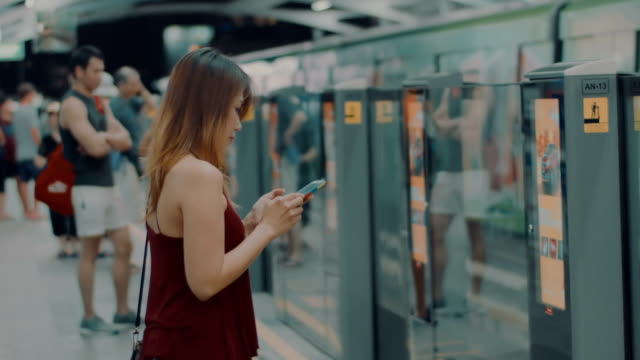 woman using phone at station