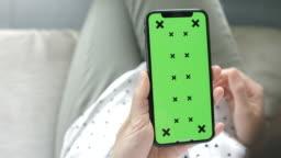 Woman Using phone green screen