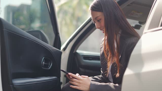 woman using phone in car - car interior stock videos & royalty-free footage